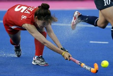 South Korea's Cha Se-na passed to a teammate during the women's hockey preliminary match against Japan.